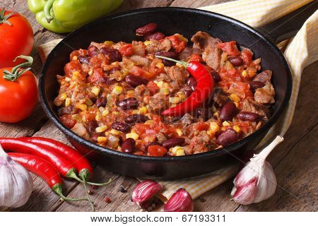 Chili Con Carne Close-up In A Frying Pan With The Ingredients.