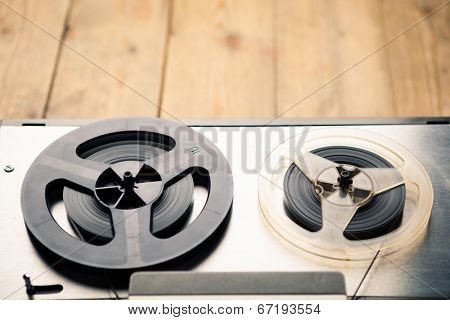 reel to reel tape player and recorder on wooden background
