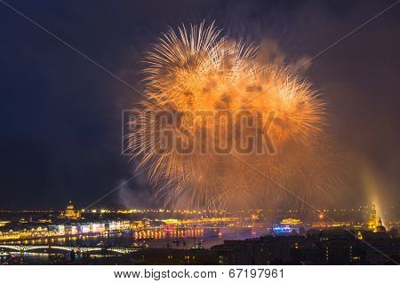 ST.PETERSBURG, RUSSIA - JUN 20, 2014: Light show and firework with a frigate with scarlet sails floating on the Neva River. In 2014, the festival Scarlet Sails celebrates its tenth anniversary.