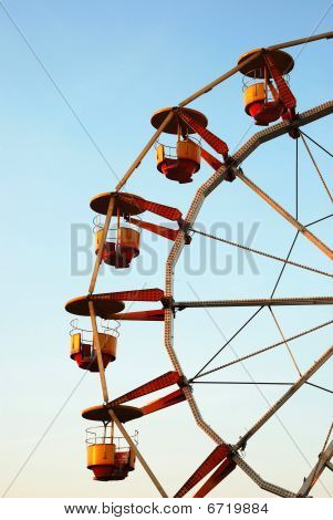 Ferris Wheel At Dusk In Autumn