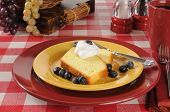 stock photo of pound cake  - Sliced pound cake with blueberries and whipped cream - JPG