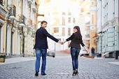 image of sweethearts  - Happy young couple in love walking at city - JPG