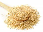 picture of sesame seed  - Wooden spoon with sesame seeds on a white background - JPG