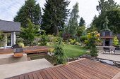 foto of lawn chair  - Back yard of a contemporary Pacific Northwest home featuring a deck a spanning creek - JPG