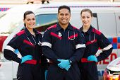 picture of paramedic  - group of paramedics standing in front of an ambulance - JPG