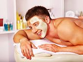 pic of beauty parlour  - Man with clay facial mask in beauty spa - JPG