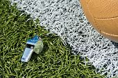 pic of offside  - Whistle and soccer ball on a soccer field - JPG