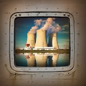 foto of nuclear disaster  - Nuclear power plant on the coast wiew from steel window - JPG