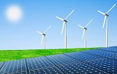picture of wind wheel  - Wind turbines and solar panels in field