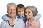 picture of grandparent child  - Happy Grandparents with grandson on white background - JPG