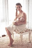 foto of breastfeeding  - Portrait of a mother breastfeeding her 3 months old baby - JPG