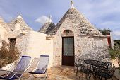 foto of conic  - Trulli houses with conical roofs in Alberobello - JPG
