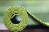 image of yoga mat  - A green yoga mat set on the floor - JPG