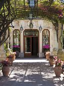 image of opulence  - Old house enter with flowered trellis from Taormina Italy - JPG