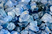 stock photo of uncut  - Set of uncut rough and raw blue sapphires - JPG