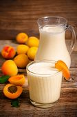 foto of apricot  - apricot milkshake with apricots slices on a dark wood background - JPG