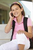 picture of pre-teen girl  - Pre teen girl with phone at school - JPG