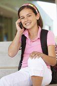 image of pre-teen girl  - Pre teen girl with phone at school - JPG