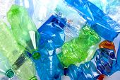 picture of reuse  - crushed multicolored plastic bottles ready to recycled - JPG