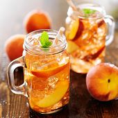 image of mason  - jar of peach tea with striped straw - JPG