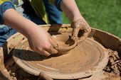 stock photo of pottery  - Children outdoor studying pottery using pottery wheel