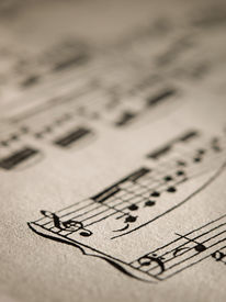 stock photo of musical scale  - Sheet of music notes, closeup for music, melody themes ** Note: Shallow depth of field - JPG