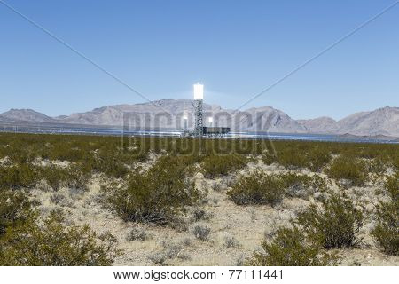 IVANPAH, CALIFORNIA - November 26, 2014:  Three glowing white hot towers at the massive 392 megawatt Ivanpah solar thermal power plant in California's Mojave desert.