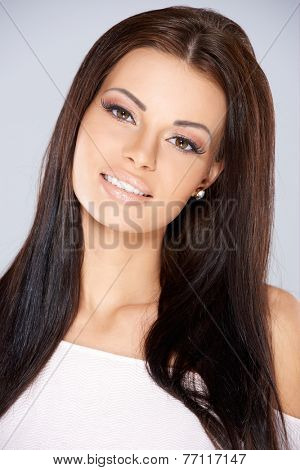 Close up Pretty Young Woman with Long Hair  Wearing White Off Shoulder Tops While Looking at the Camera. Isolated on Gray Background.