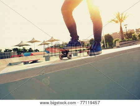 skateboarding legs at skatepark