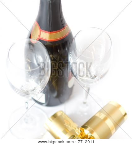 Champagne Bottle With Glasses And Xmas Crackers Isolated On White