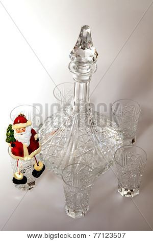 Ware for table for New year dinner. Crystal shot glasses and decanter