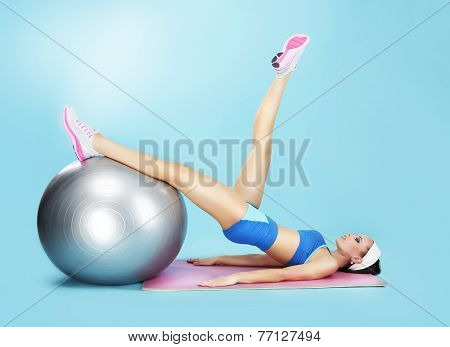 Aerobics. Sportswoman In Sport Club With Fitness Ball