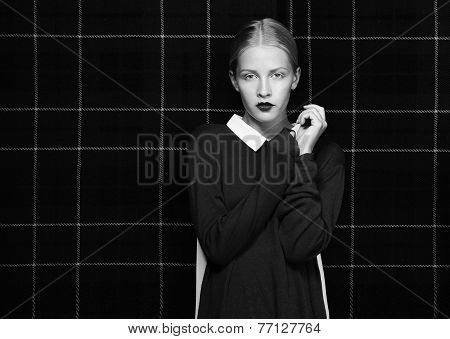 Glam. Attractive Female Hipster In Shadows Posing