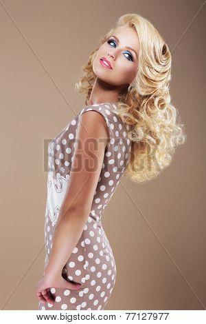 Graceful Woman In Retro Polka Dot Dress Looking Back