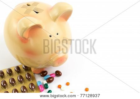 Piggy Bank With Medical Patches And Pills Isolated On White