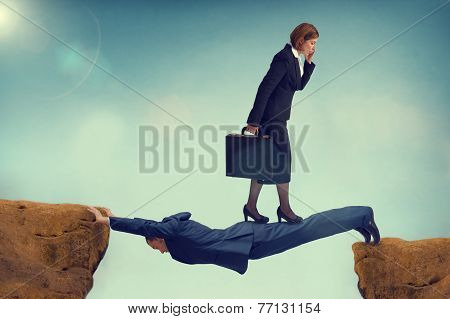 Ruthless Business Woman Walking Over A Vulnerable Businessman