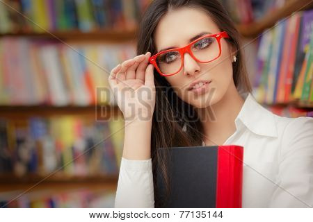 Young Woman Wearing  Glasses and Holding a Book