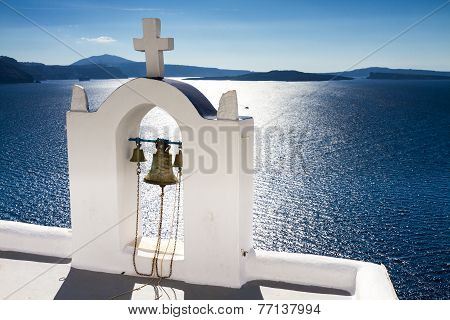 White Bell Tower Over The Mediterranean Sea