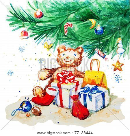 Toy bear and gifts under the Christmas tree