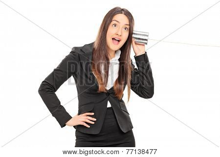 Businesswoman having fun with a tin can phone isolated on white background