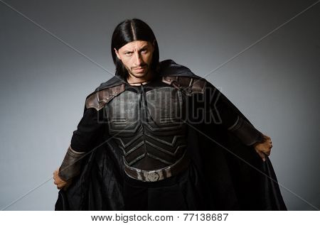 Angry warrior against dark background