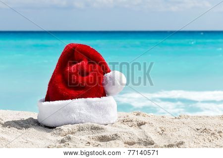 Santa Claus Hat At Caribbean Sandy Beach, Cancun