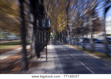 cyclist speeding down a urban cycle path
