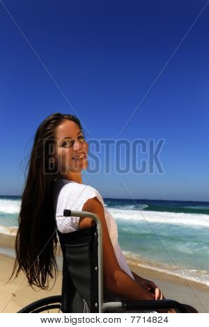Woman In Wheelchair Enjoying Outdoors Beach
