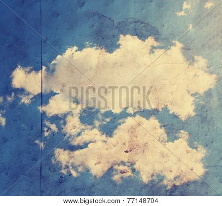 paper texture background with clouds toned with a retro vintage instagram filter