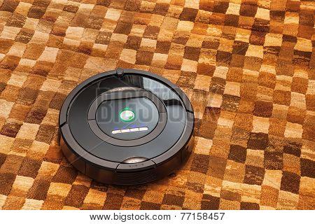 Robotic vacuum cleaner on carpet - technology housework