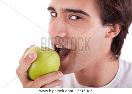 Man Eating A Green Apple, Isolated On White Background. Studio Shot.