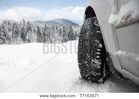 Winter tire in snow �¢?? close up