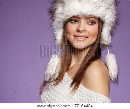 Fur Fashion. Beautiful Girl in Fur Hat. Winter Woman Portrait