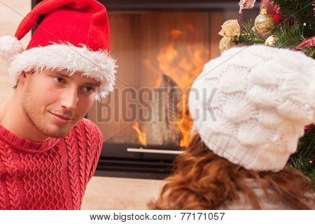 Couple Sittng By The Fireplace